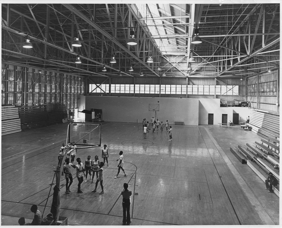 Students playing basket ball in the old CVI gym