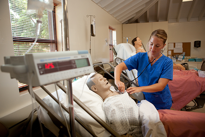 Nursing student practicing her nursing skills.