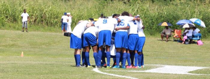 UVI Soccer team huddle during the Inaugural game.
