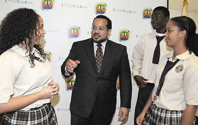 Seventh-Day Adventist seniors, from left, Kalina Webster, Keryl Liburd and Kamira Webster talk to Oson VI, LLC Founder and Chairman Dale LeFebvre after a check presentation ceremony on Dec. 3, on UVI's St. Thomas Campus. The students among some 28 who participated in last summer's University Bound SAT Prep Program at UVI, which is among the programs to receive support from LeFebvre's presentation.