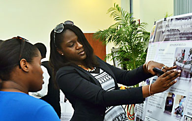 Jamila Martin, a UVI senior majoring in applied mathematics, gives a poster presentation on the UVI Saint Thomas Campus