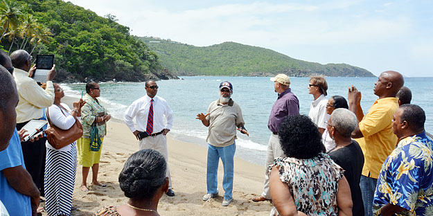 Photo of family donation to UVI at Hendricks Beach