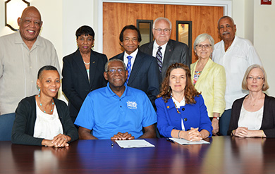UVI President David Hall and UVI Provost Dr. Camille McKayle pose for a photo with Fielding University officials and UVI administrators and faculty.