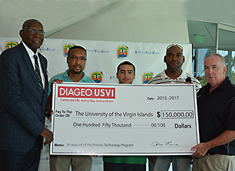 UVI President David Hall, UVI director of the Process Technology Program Eric Douglas,  UVI Process Technology student Alex Cintron,  UVI Process Technology student Thyrone DeCosta and Colman Hanna, vice president of operations at Diageo USVI pose for a photo.