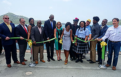 UVI President David Hall and VI Next Generation Network  President and CEO Dr. Tonjia Coverdale participate, along with others, in ribbon cutting ceremony on the Waterfront on St. Thomas.