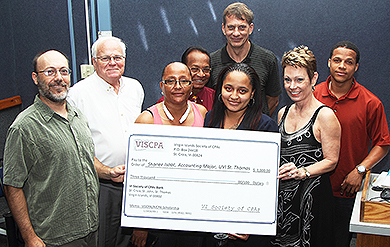Rob Upson  and Dr. Sherri Levin, of the Virgin Islands Society of Certified Public Accountants, presents UVI Accounting Student Shanee Isaac with a scholarship, while UVI staffers Dr. Stephen Reames, UVI Dean of the School of Business, Dr. James S. Maddirala and Dr. Dion Gouws  stand in the background.