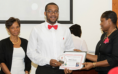 UVI student Oldain Claxton receives UVI Student Peer Educator certificate from Michelle Albany on St. Thomas Campus
