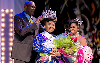 Miss UVI Che-Raina Warner is crowned by UVI President David Hall as former Miss UVI Katherine Callwood assists.