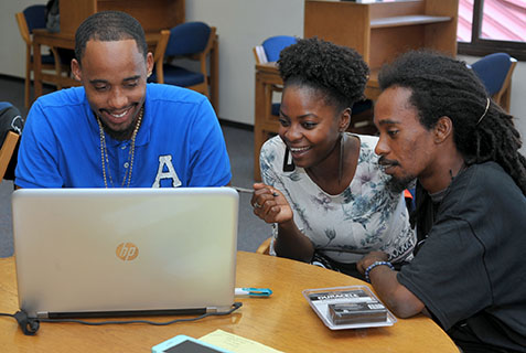 Terrance Emmanuel, Leanne Morancie and Geron Richards strategize at HackFest.