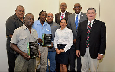 UVi Physical Plant employees accept the Presidential Appreciation Award.