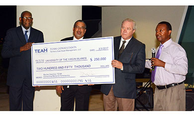 UVI President David Hall Receives a Check on Behalf of Rachel Hamilton