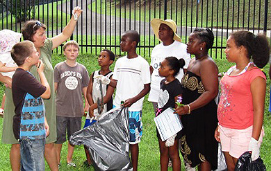 Volunteers gather for instructions to begin clean-up effort.