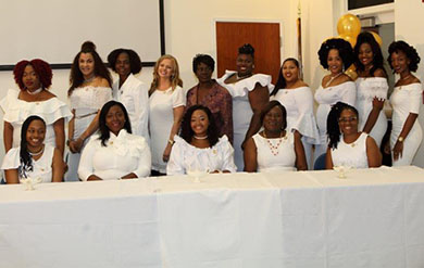 Practical Nurses from the University gather at the Pinning Ceremony.