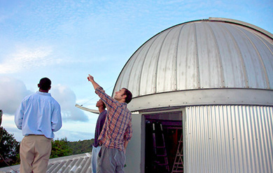 UVI observatory with students pointing to the sky