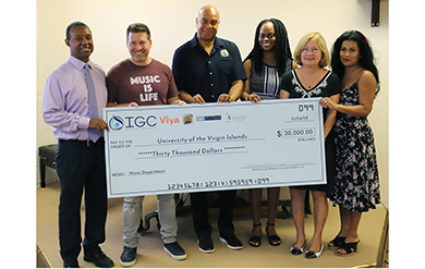 Vice President of Institutional Advancement Mitchell Neaves, Paul Talbert, Dion Parson, Dr. Kimarie Engerman, Marjorie Rawls Robert P.C. and Cindy Talbert pose at a check presentation held in the Music Building on the St. Thomas Campus