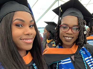 The Henry Sisters display their Smiles as Graduates of the University of the Virgin Islands.