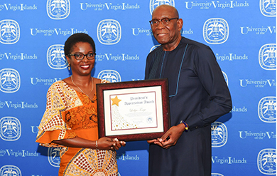 Leslyn Tonge receives President's Award from President David Hall