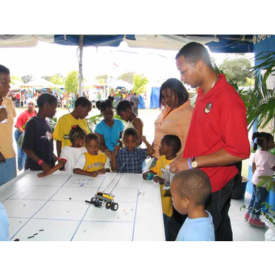 Marthious Clavier of the Cooperative Extension Service (CES) Interacts with Children