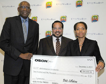 UVI President David Hall (left) and UVI Vice President for Institutional Advancement Dionne Jackson accept a donation from Oson VI, LLC Founder and Chairman Dale LeFebvre on Dec. 3, on UVI's St. Thomas Campus.